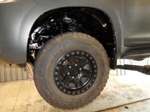 Unterbodenschutz an einem Fahrzeug